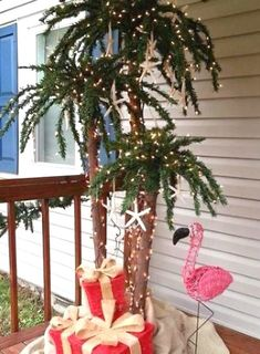 Coastal Christmas Palm Tree with Pink Flamingo: http://www.completely-coastal.com/2015/12/coastal-christmas-trees-reader-submissions.html