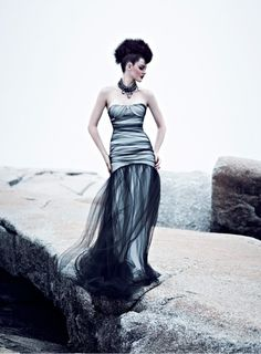 Black remains a chic option for your wedding gown and we love this stunning dress with tulle overlay.