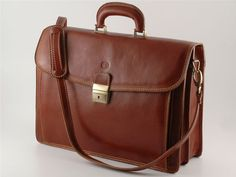 Napoli leather Briefcase is big enough to hold a laptop, files, a newspaper, and notebooks. It is divided into three compartments for easy organization and has an additional outside pocket. The top swings open for easy access to all of your files and has a locking buckle strap to secure it. Napoli leather Briefcase is handmade in Tuscany using Italian polished calf-skin leather and old world craft methods. The result is a timeless and simple briefcase with unquestionable quality and…