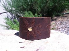 OOAK leather cuff/carved cuff/floral by longshotleather on Etsy #leathercuffs #upcycledleathercuffs #longshotleather