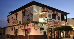 An island tradition since 1941, a visit to Charlie's Bar is filled with fun and camaraderie. Come and enjoy the great food and unique atmosphere of this famous bar in Aruba filled with decades of international memorabilia.