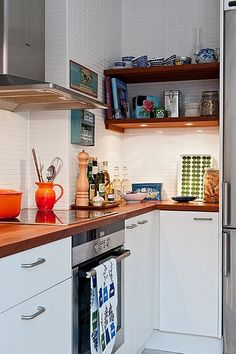 White  Kitchen Cupboards and wooden countertops