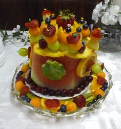 Watermelon cake by Cherri. Learn how to make your own watermelon cake at http://www.vegetablefruitcarving.com/watermelon-cakes/