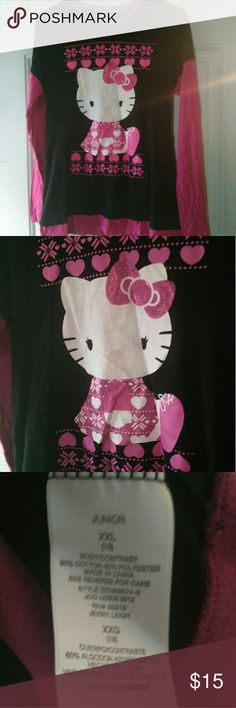 Junior's XXL (Plus Sz) Long Sleeve Hello Kitty Top Beautiful & adorned with hot pink Glitter featuring a GIANT hello Kitty face & body on it the long sleeve hello Kitty knit Top/ Long sleeve T-shirt with black Body & pink sleeves & collar and embellished in pink at the bottom. It's made to look like the 90s when two shirts were worn a long sleeve with a short sleeve over top, that layers of clothes look. There's also a snow flake design in the shirt. XXL in Jr, perfect condition no rips or…
