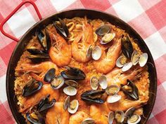 This is a dramatic seafood paella, which looks stunning with crustaceans and shellfish. You can vary the quantities of seafood and also use crab, crayfish, or lobster (boil them separately).