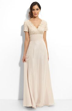 Almost everything I want... lace overlay, deep V in back, long flowing A-line, fantastic thrifty price.  Just gotta nix the sleeves!  JS Boutique Beaded Lace & Chiffon Gown in Champagne, $158.