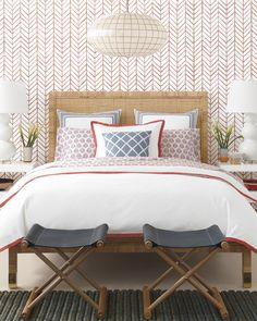 A chevron wallpaper adds a punch of pattern and color to this chic bedroom with a rattan bed, leather stools, and elegant chandelier. Decor, Furniture, Feather Wallpaper, Kids Bedroom Designs, Luxurious Bedrooms, Rattan Bed, Home Decor, Luxury Bedroom Master, Luxury Duvet Covers