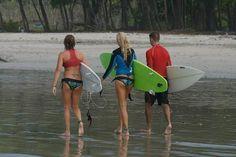 8 Day Backpacking Guide to Costa Rica- cheap! surfers walking beach playa el carmen   - Costa Rica