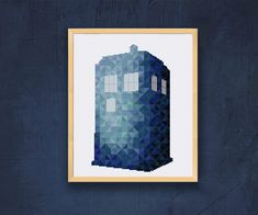 Modern geometric Tardis cross stitch pattern or cross stitch kit from Dr Who in shades of blue is a fun project to stitch and an awesome item to display.