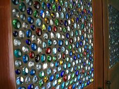 Use glass pebbles and grout to create a stained glass window.  Would be great in a bathroom or on the utility room door.