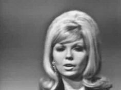 "Nancy Sinatra ~ ""These Boots Are Made For Walking"" ~ 1966  (Despite the scrolling information regarding her UK success at the time.  In the US, she had 10 top 40 hits and two number one hits.)  She is the daughter of Frank Sinatra.  The sang a duet, ""Something Stupid"" which reached #1 in the US."