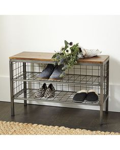 Vintage industrial shoe storage for the mudroom or dressing area. Sturdy metal frame supports two wire shelves with enough space beneath the lowest for several extra pairs. Wood top creates a convenient place to perch for changing shoes. Cambridge Shoe Bench features: Handmade of mango wood & metalZinc finishFully assembled