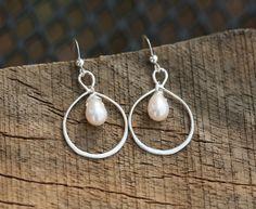 Infinity earringsSterling silver infinity pearl by tydesign, $25.00