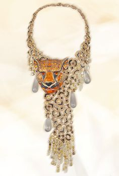 With his noble fire opal face and his robe of coloured #diamonds the tiger necklace burns bright