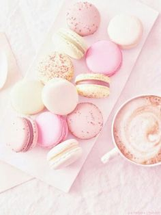 Pink macaroons and coffee.