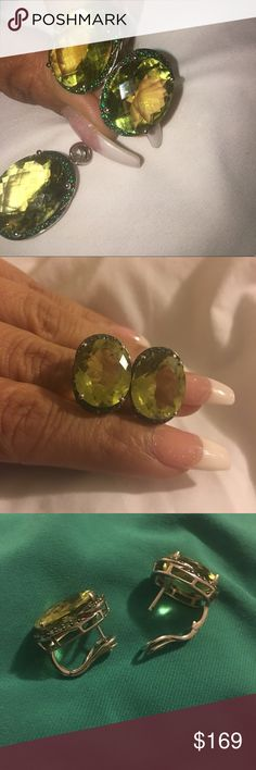 Peridot earrings & pendant Stunning Peridot earrings & pendant 925 silver huge oval stones omega back earrings. Please one of the earrings needs to be adjusted it does not closed properly hence the price reduction Jewelry Earrings