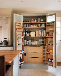 Wow. Look at the storage capability inside this kitchen hutch/cupboard! (kitchen storage idea)