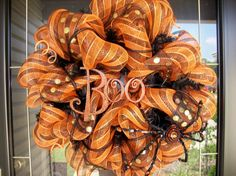 "~Halloween Boo Wreath...24""  Black and orange stripe mesh ribbon with gold glitter polka dots"