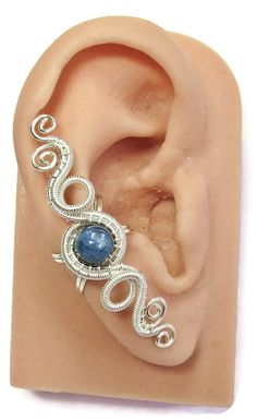 This lovely, modern ear cuff was wire-wrapped by-hand with tarnish-resistant silver-plated wire and features a rich, silvery-blue, spherical