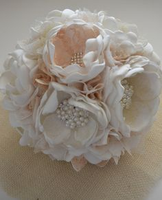 Hey, I found this really awesome Etsy listing at https://www.etsy.com/listing/197947194/ivory-and-gold-bridal-bouquet-and-toss