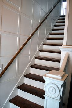 Wood and white staircaste with wainscoting by newlywoodwards, via Flickr