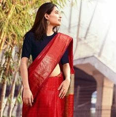 This saree is awesome! Black shirt - red traditional saree - earrings Black Saree Blouse, Saree Dress, Red Saree, Saree Draping Styles, Saree Styles, Saree Blouse Patterns, Saree Blouse Designs, Indian Attire, Indian Ethnic Wear