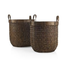 Woven of rattan, these handy baskets are shaped tall for lots of storage.   Solid rattan contrasts with the textural body, shaping a decorative rim and handles.  The underlying metal frame helps keep the basket sturdy even when filled.  Due to the natural color of rattan, color variations will occur. RattanMetal frameWipe clean with soft dry clothMade in The Philippines.