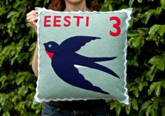 Estonian swallow stamp cushion cover by TouchWoodDesign on Etsy, $100.00