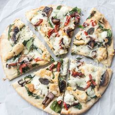 Thin pita or flatbread with chicken, mushrooms, pepper, spinach, tomatoes, goat cheese and mozzarella cheese. So easy to make and so delicious. ValentinasCorner.com