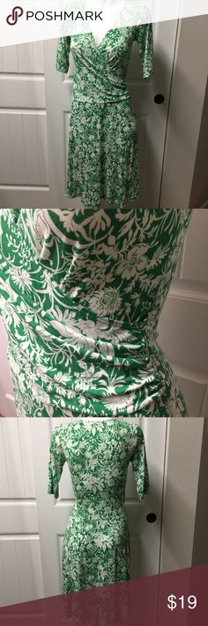 """CAbi Green White Floral Wrap 572 Dress Small CAbi Green White Floral Print Faux Wrap Style# 572 Jersey Knit Dress Size Small  Beautiful green and white CAbi dress. Faux wrap. Rayon spandex blend. Tagged small but please see measurements to ensure proper fit. Measured flat unstretched   Bust 15.5"""" Length 41""""  See photos. Ask any questions before purchasing CAbi Dresses Midi"""