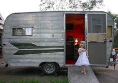 And this is why vintage trailers of small size are big  hits with the ladies. Our own playhouse in a grown up dream.  Vintage Aristocrat - photo by Lake Kowell