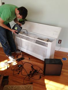 Use an old radiator cover as a tv stand. All the cords can go inside!