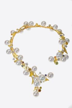 Hand fabricated pearl necklace, 18kyg, diamonds, multicolored sapphires. Largest cultured, fresh water pearls in the world. Designed for Somewhere in the Rainbow collection by Brenda Smith.
