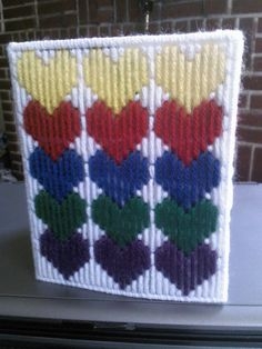 Made with yellow, red, blue, green, and purple yarn. Comes with a boutique tissue box. This is already made by hand and ready to ship. Combined shipping is always offered