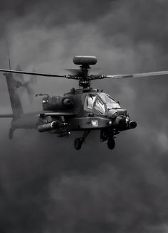 An Army Air Corps Apache emerges from smoke during a role demo display at 2014 RIAT Attack Helicopter, Military Helicopter, Military Aircraft, Military Personnel, Military Vehicles, Ah 64 Apache, Aircraft Photos, War Machine, Air Force