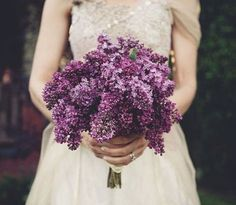Lilacs. Maybe with baby's breath, for the bride to keep.