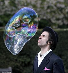 Samsam Bubbleman broke his own world record for the most bubbles in a bubble. (His bubble formula remains a secret!) by Pamela Owen, dailymail.co.uk. Photo by Barcroft Media #Samsam_Bubbleman #Pamela_Owen #dailymail_co_uk  #Barcroft_Media