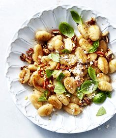 "Gnocchi With Brown Butter, Pecans, and Basil | Everything about ""gnocchi"" screams fancy, but luckily you can buy a premade version in the supermarket that takes just a couple of minutes to cook at home. We love the Gia Russa brand, but any shelf-stable version is perfectly fine to use. Browned butter takes this dish over the top, but luckily, you don't have to babysit it: the butter will brown while you're cooking crushed garlic cloves and coa..."