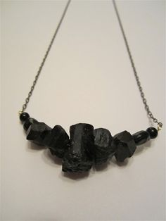 lump of coal necklace with black crystals