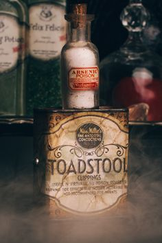 Vintage spice can turned into a DYI Harry Potter Potion for Halloween: Toadstool/Arsenic - Scrapbook.com