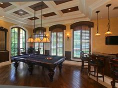 Billiards room with bar