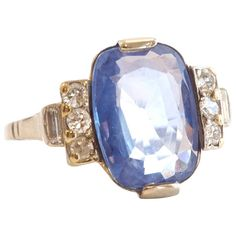 Art Deco Sapphire Diamond Platinum Ring. Beautiful light blue natural sapphire from Ceylon with no indications of heat or other treatment. The weight is approximately 5 carats. c 1930s