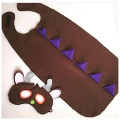 A perfect gift for all Gruffalo and monster lovers! Kids love running around in my kids Gruffalo costume. Each Gruffalo cape and Gruffalo mask set encourages imaginative play. My Gruffalo outfits are a fantastic gift or must-have costume for a themed kids Gruffalo party. They are also great in other colours for a dinosaur/dragon outfit. Each outfit is custom made just for you, to your choice of size. One customer sums up my kids Gruffalo costume perfectly: ⭐⭐⭐⭐⭐ Our little boy loves it!...
