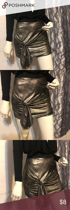 Metallic Skirt Metallic skirt with knot on the side! Perfect to piece to make your look STAND OUT! Great for holiday season! H&M Skirts Asymmetrical
