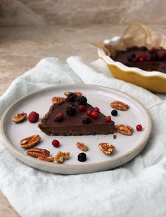 This was almost as fun to make as it was to eat. That's because the crust is simply made of toasted pecans, maple, coconut oil and salt blitzed up in a food processor. And the dark chocolate mousse filling comes together quickly in one sauce pan on the stovetop. Once the two components are layered i
