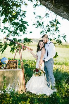 telescope wedding - photo by Dawn Photography http://ruffledblog.com/galileo-inspired-wedding-ideas