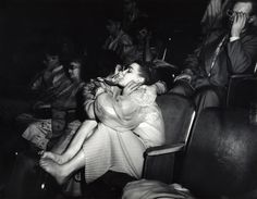 Lovers with 3-D glasses at the Palace Theatre (Infra-red), 1943, by Weegee