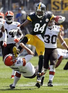 Pittsburgh Steelers Antonio Brown kicks Cleveland Browns punter Spencer Lanning as he jumps while returning a punt in the second quarter of the NFL football game on Sunday, Sept. in Pittsburgh.love the browns but it was the funniest thing ever! Steelers Pics, Pittsburgh Steelers Football, Pittsburgh Sports, Best Football Team, Steelers Helmet, Steelers Stuff, Football Memes, Nfl Sports, Football Players