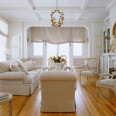 Choose Real Wood for Lasting Beauty  real wood floors, that's what I'm talking about!  This is a no fuss, classically beautiful seating area. Love the look of the soft white color scheme.