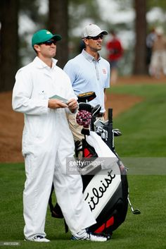 142ef76ee4892 Adam Scott of Australia and caddie Mike Kerr look on during a practice round  prior to